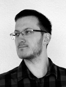 Dr. Thomas A. Neubauer Portraitfoto in Graustufen